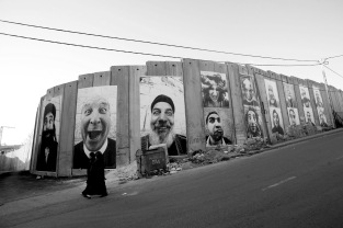 JR, 28 Millimetres, Face 2 Face - Pasting on the Separation wall ; Security Fence, Palestinian side, Bethlehem.
